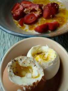 Soothing breakfast: soft-boiled eggs and strawberries