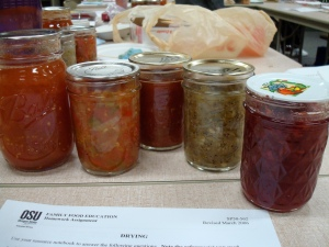 Canned tomatoes, salsas and jam (left to right) from food preservation class.